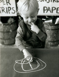 boy drawing circle